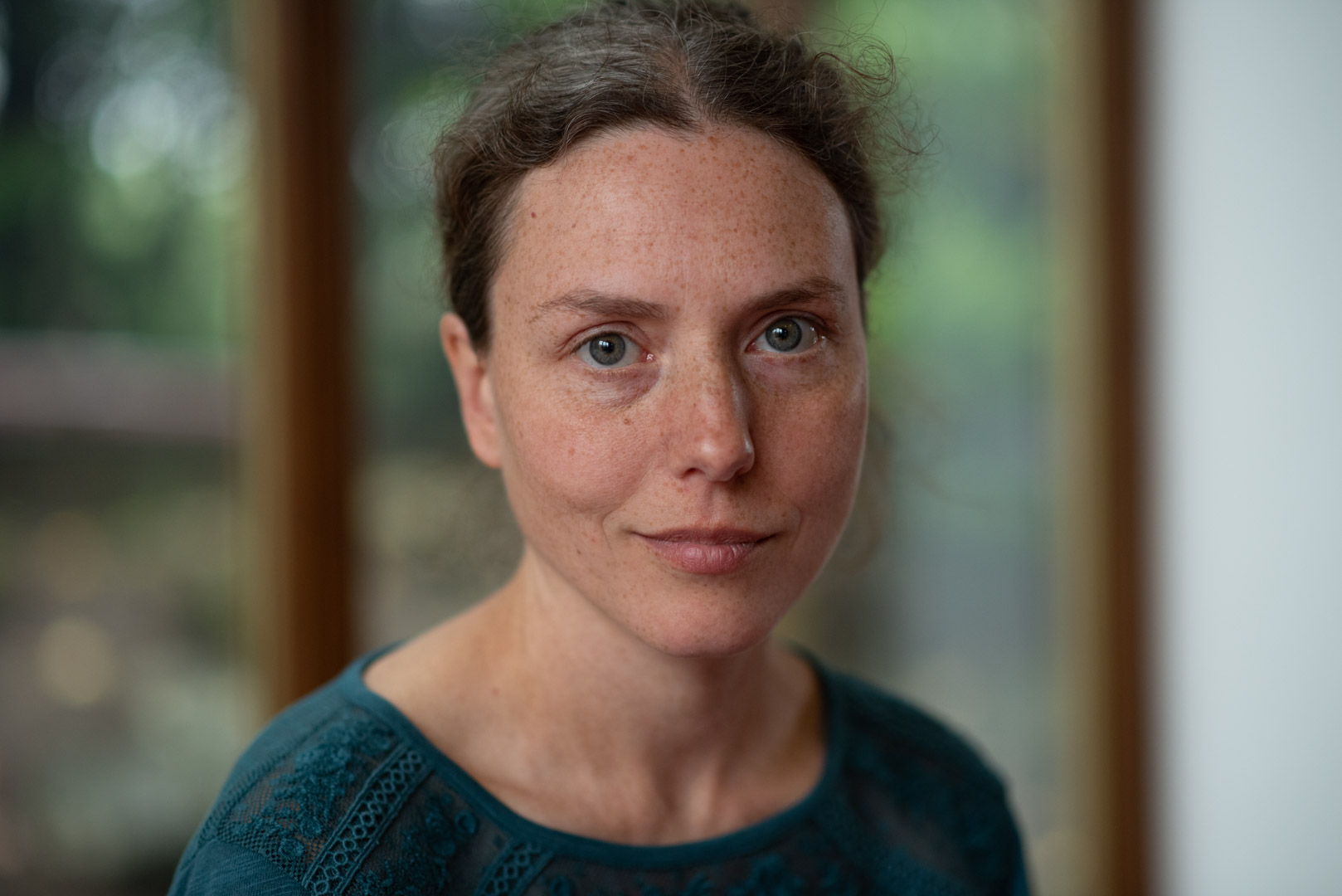 Tatiana Aitken tantric therapist wearing teal top looking at camera