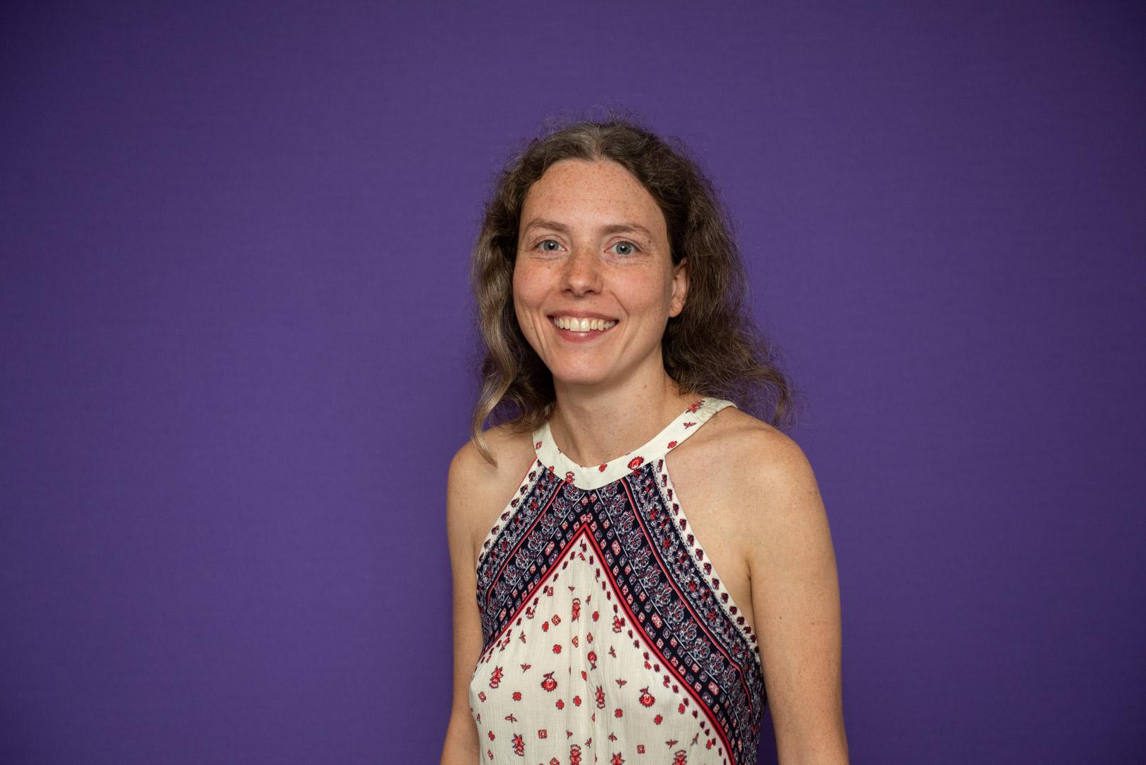 Tatiana Aitken tantric massage therapist wearing a blue and white dress